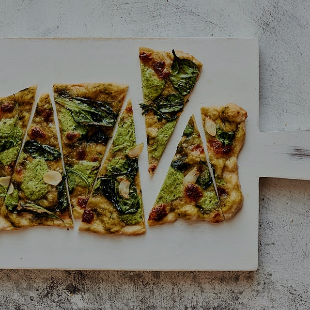 Greens pesto pizza with a healthy dose of garlic on a delightfully thin and crispy crust. #Flavor...