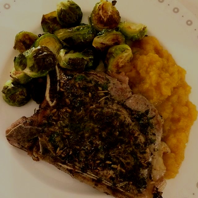 fennel seed and herb-crusted pork chop, pumpkin caramel apple sauce, brussels sprouts... dinner