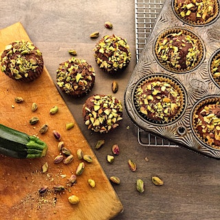 It's a cool, dreary Saturday. Translation: Baking Day. My muffin tin fits into the toaster oven, so I had to make Chocolate Zucchini Muffins with a pistachio crust. Had to. 😉
