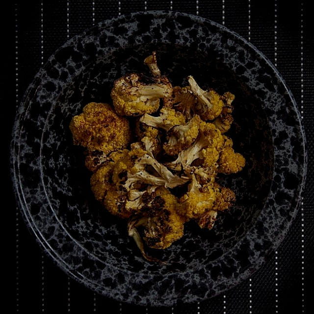 A roasted curried cauliflower dish, if you will! POW!!!