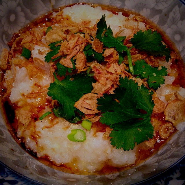 Dinner for sick Malaysian woman: Homemade fish congee. Mum would make this for us whenever we got...