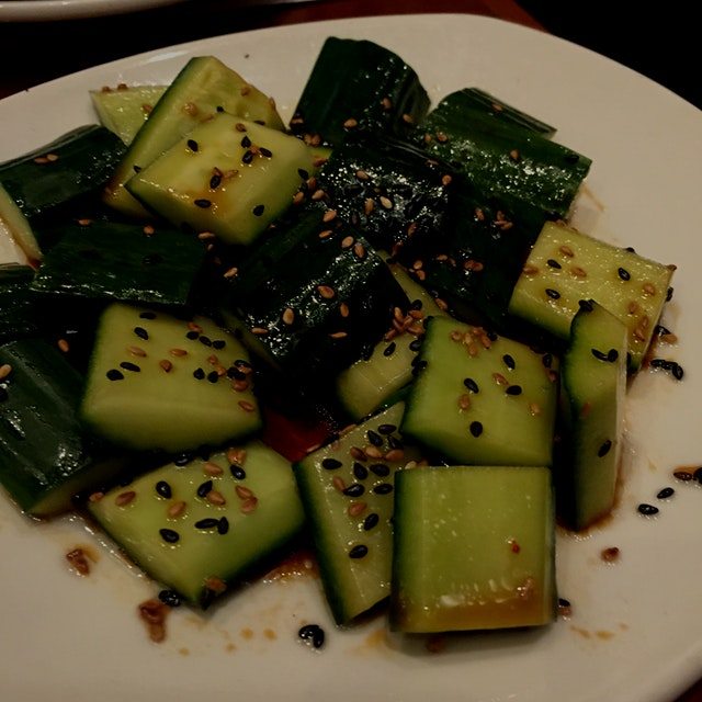 Amazing cucumber salad! Cucumbers, soy sauce, and sesame seeds. Favorite dish of entire dinner!
