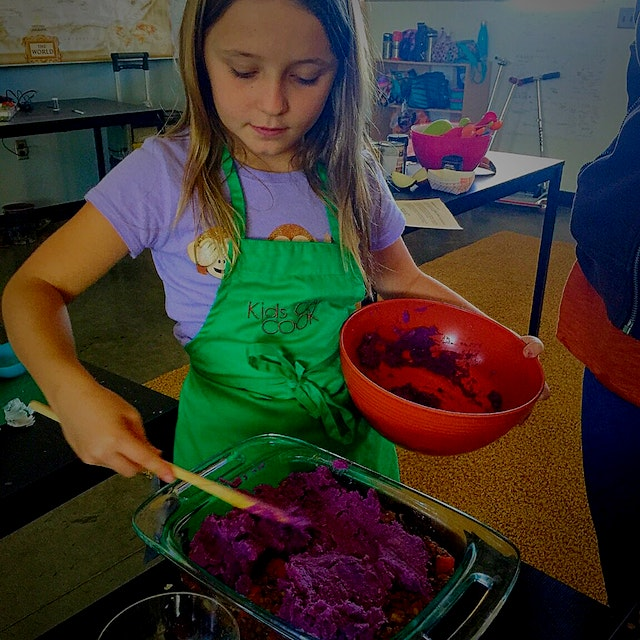 """Our HAPPY Chef making a purple sweet potato & lentil """"Shepards pie"""" during our fun, hands-on, pla..."""