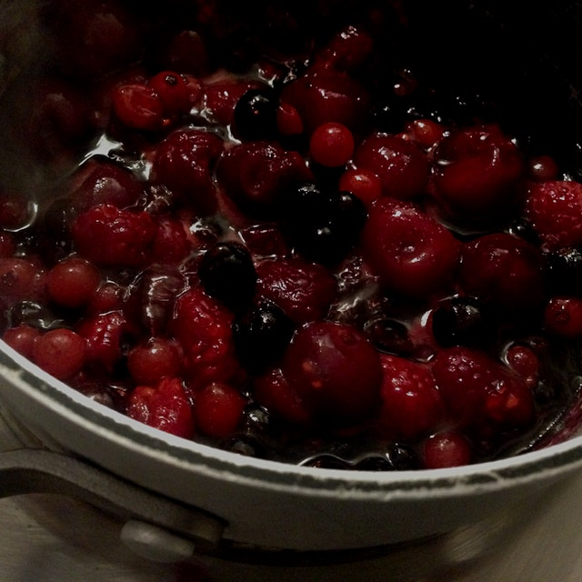 Boiling some mixed frozen berries for ice cream topping! Add some sugar, boom💥.