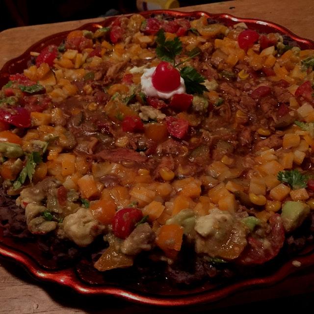 Chicken Calabazita dip. Refried black beans, cumin-scented chicken, calabazita, and corn. Topped ...