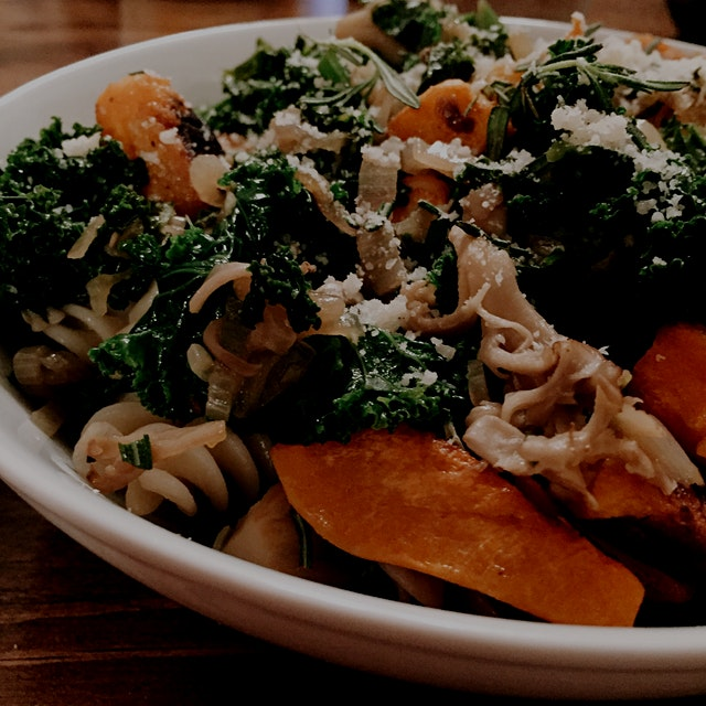 Roasted butternut squash with kale, shallots and maitake mushrooms over brown rice pasta for the ...