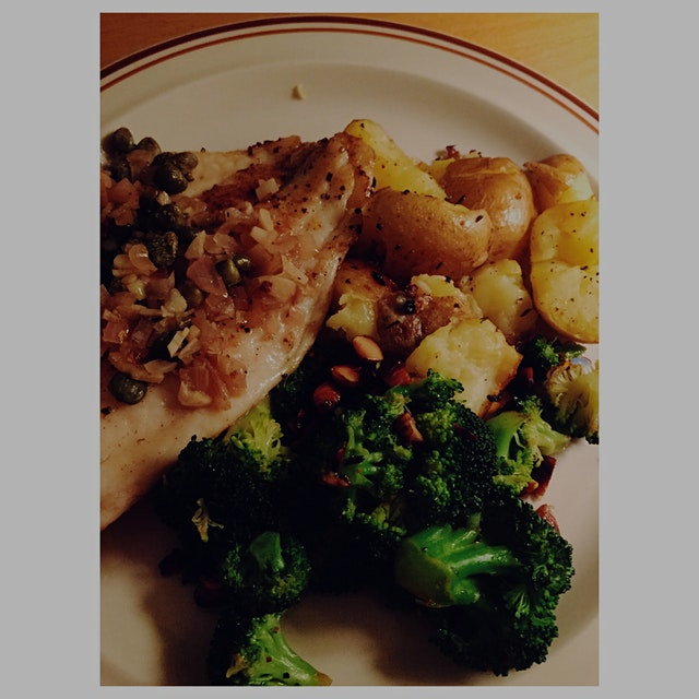 Pan-seared Tilapia with shallot, caper, garlic, white wine sauce. Roasted Broccoli with chopped A...