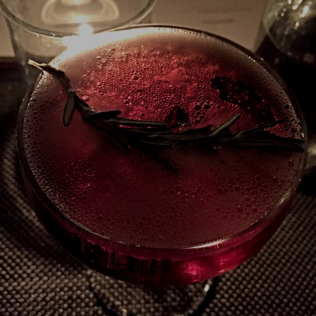 Cassis & desist: champagne with cassis and a sprig of rosemary.  Perfect holiday cocktail with @r...