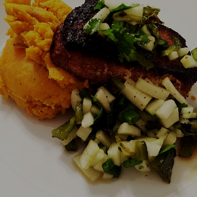 Spiced pork chop with poblano apple salsa and olive oil smashed sweet potatoes