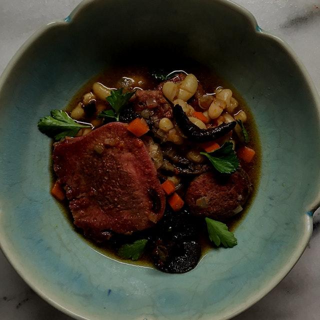 Goose sausage, beef tongue, sullius americanus, beans, goose broth.