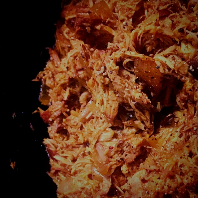 In my crockpot: Chicken Thighs, braised in Barbecue sauce with Garlic Cloves, Yellow Onion, Whole...