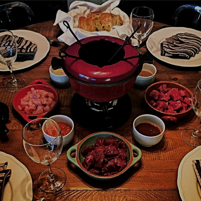 Cook's night off. Letting the guests cook their own dinner! 😉 Fondue with ostrich, venison, ribey...