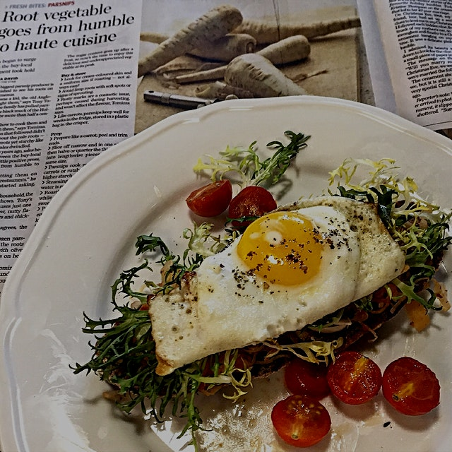 Starting off the week with a sunny side up egg on homemade rye, frisée and kimchi. And in other n...