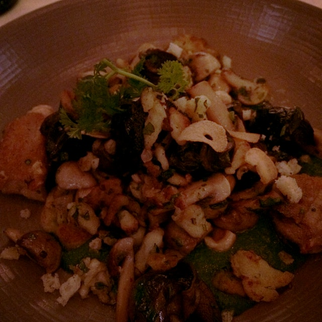 Deconstructing the classic Escargot - Burgundy snails are served with spaetzle, tossed with Mushr...