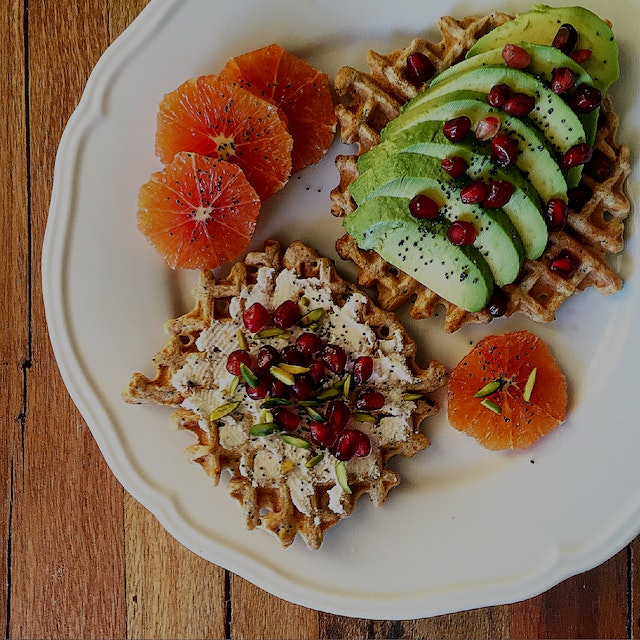Had leftover savoury Harissa waffles. Now they're toast! With ricotta, avocado, pomegranate and p...
