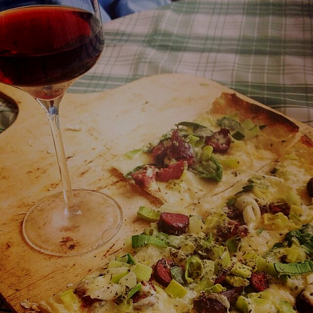 Love being home! Flammkuchen with venison, spring onions, and cheese with local Pinot Noir at the...