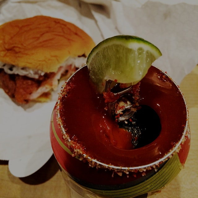 Washing down that spicy Chicken sandwich with a Michelada - a can of Tecate is topped with house ...