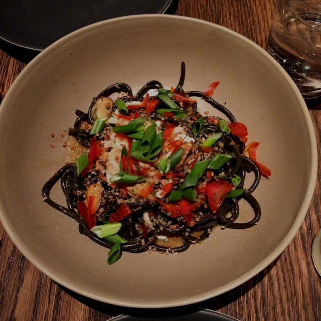 A fresh taste of the sea from this Philadelphia import. House made Seaweed bucatini with spicy Po...