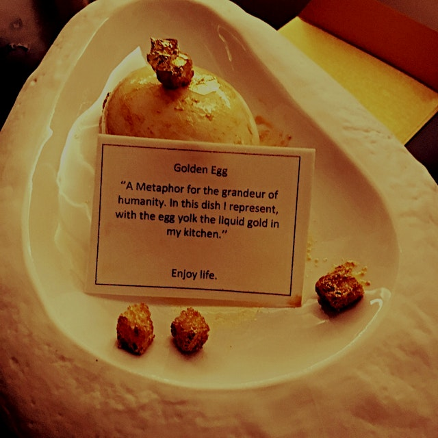 Golden egg with edible note card.. Just one of the many impressive courses currently featured at ...