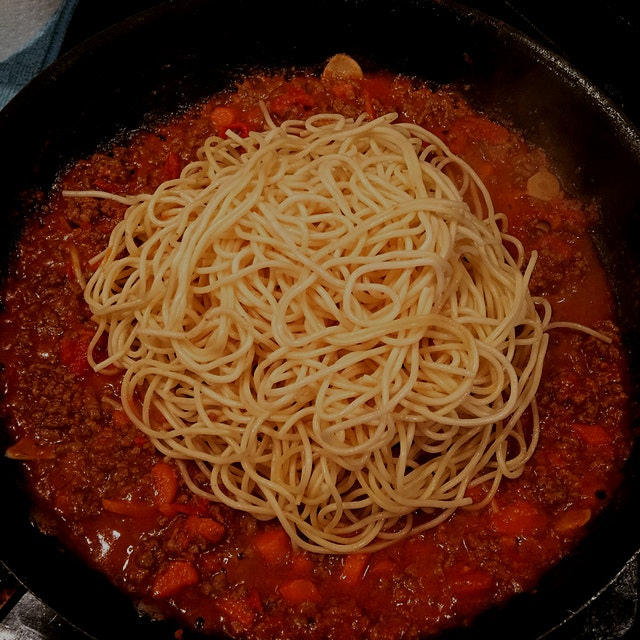 "Cook your pasta to ""al dente,"" remove from boiling water and throw directly into sauce. Keep sauc..."