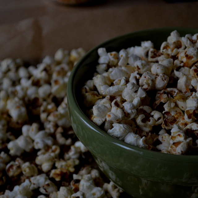 """I can't resist Smartfood popcorn. Here is a DIY version of the snack aisle treat: parmesan popco..."
