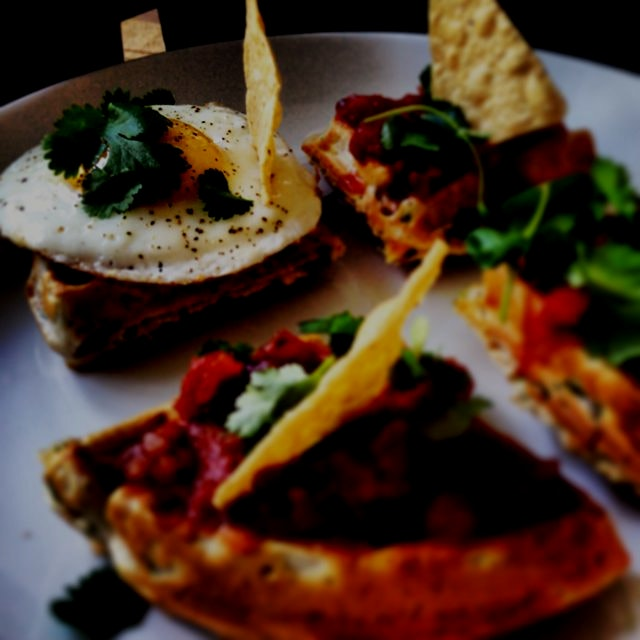 #colors of my savory brunch party! Chive waffles topped with sunny side up well treated egg, sals...