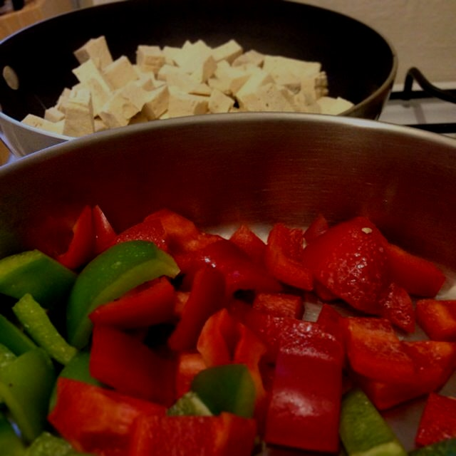 A #colorful dinner! Some fresh peppers, tofu and mixed in some black beans with a little hit sauc...