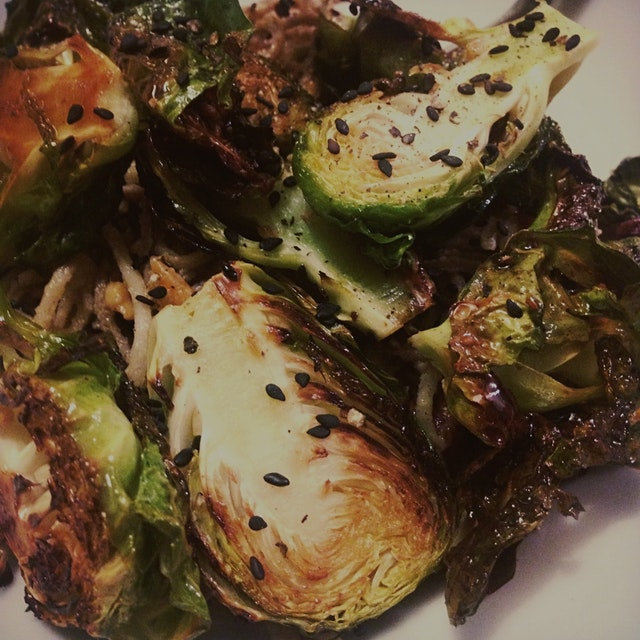 Bake the brussel sprouts in the oven while preparing the sauce. Wait until they are slightly char...