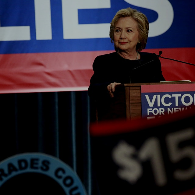 """Hillary Clinton linked herself to a successful effort to raise the minimum wage to $15 an hour M..."