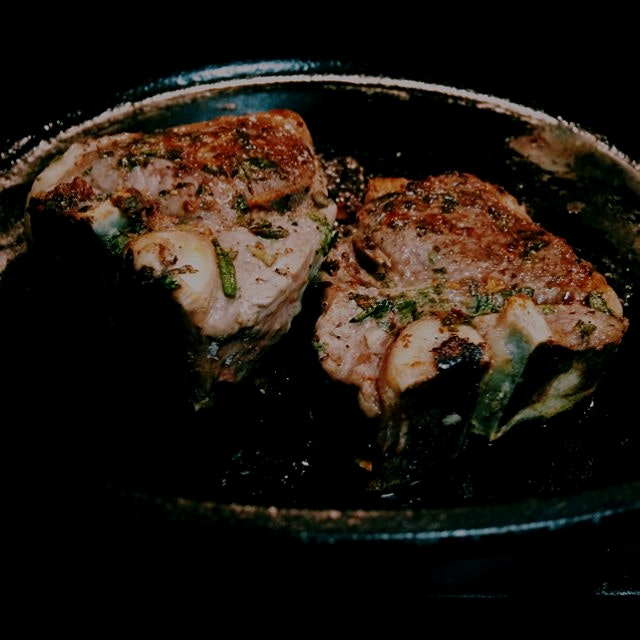 Loin lamb chop with fresh thyme, parsley, sage, and garlic, topped with a portobello balsamic red...