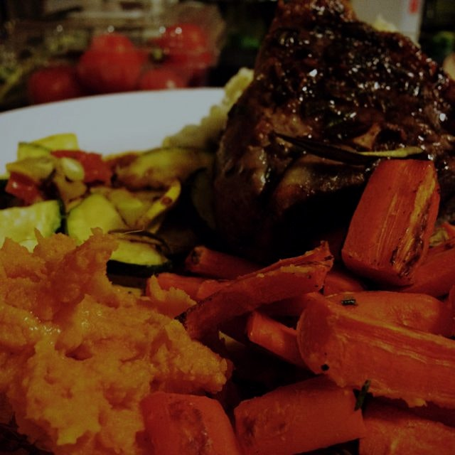 Seared loin of lamb, roasted carrots, mashed sweet potatoes, and grilled zucchini and squash. Fir...