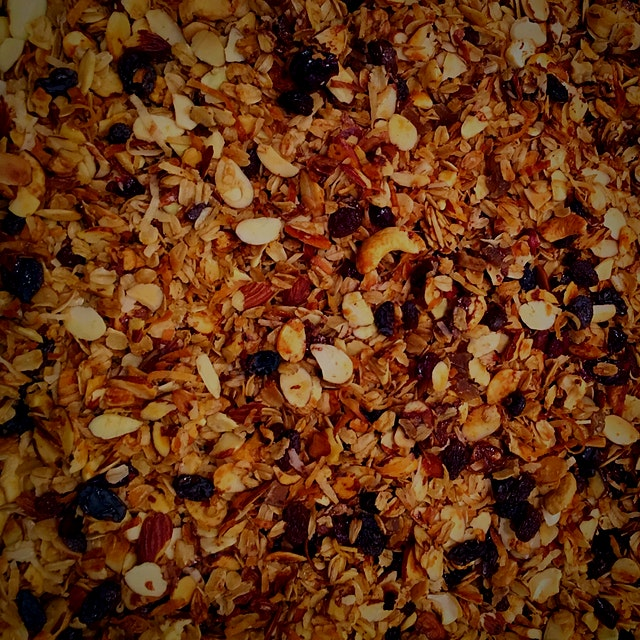 I've fallen in love with making my own granola!  You can add whatever -grains, nuts, seeds, dried...