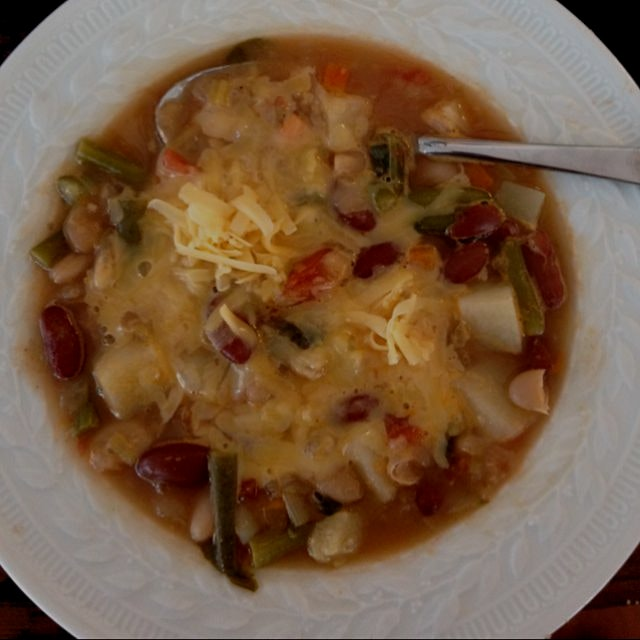 I love homemade Minestrone Soup with lots of sharp cheddar cheese sprinkled on top!