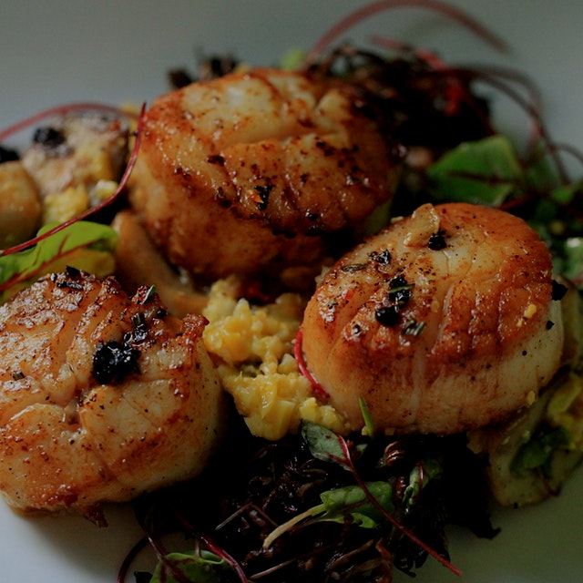 """Succulent seared scallops paired with marinated mushrooms and red vein  sorrel make a decadent d..."