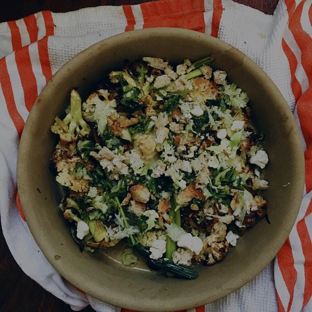 Roasted cauliflower topped with green garlic, lemon zest, lemon juice, olive oil, parsley, breadc...