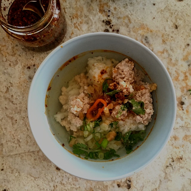 Khao Tom Moo - Homemade Thai rice soup traditionally eaten in the morning. This comforting dish i...
