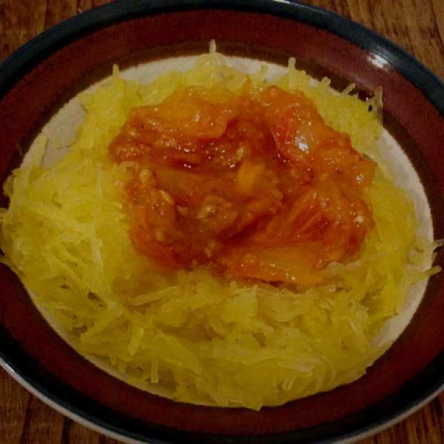Tastes better than it looks! #Organic spaghetti squash with an heirloom tomatoe, garlic and red w...