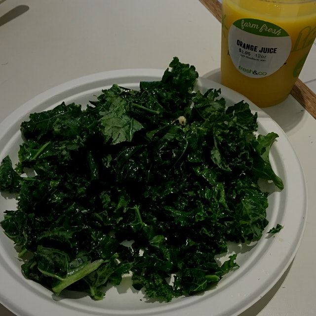 Fresh made sautéed kale and OJ @PizzaCat ordered this for breakfast at Fresh & Co.