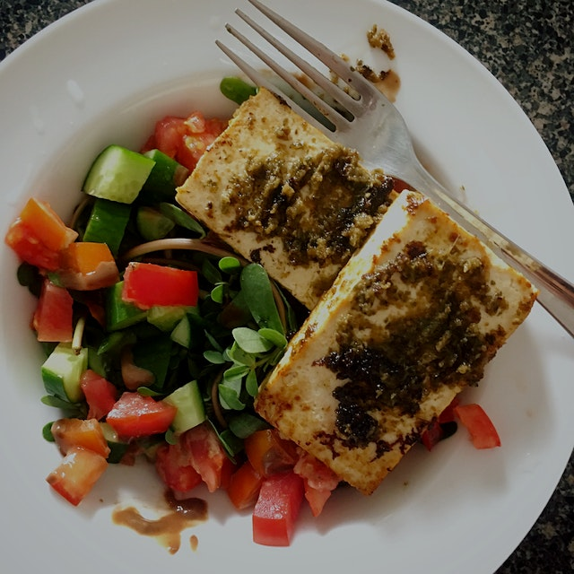 Grilled tofu with Lime Leaf Sambal. Purslane and tomato from the garden. Cukes. Homemade sesame r...