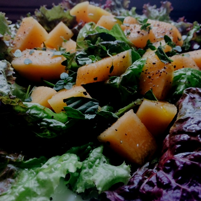 Ripe cantaloupe, fresh herbs and a drizzle of white wine vinegar and olive oil over lettuce make ...