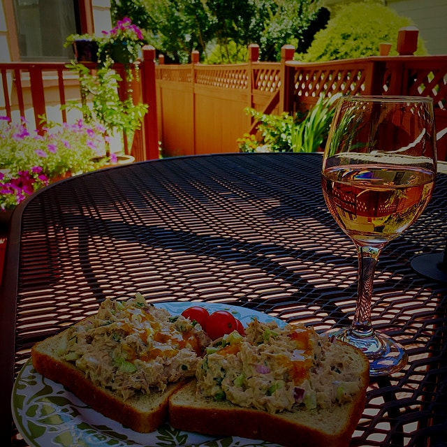 Solo lunch out on the back deck. That's some super spicy Scotch Bonnet hot sauce that a friend br...
