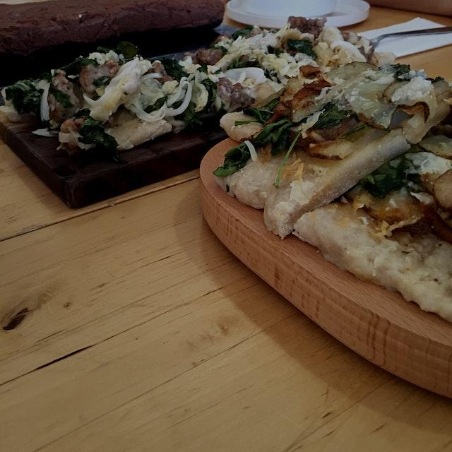 Scott makes Italian   Mozzarella tomato arugula salad Pasta Potato leek pizza Sausage onion garli...