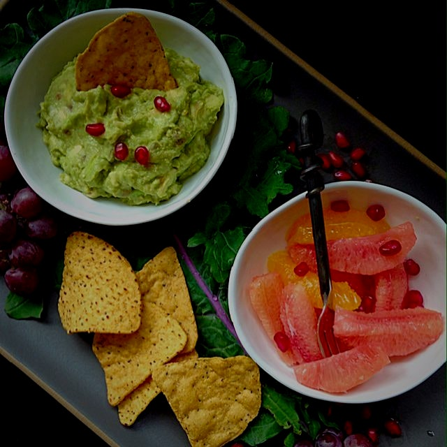 Snack time! Avocado mash and fresh citrus fruit with pumpkin tortilla chips!