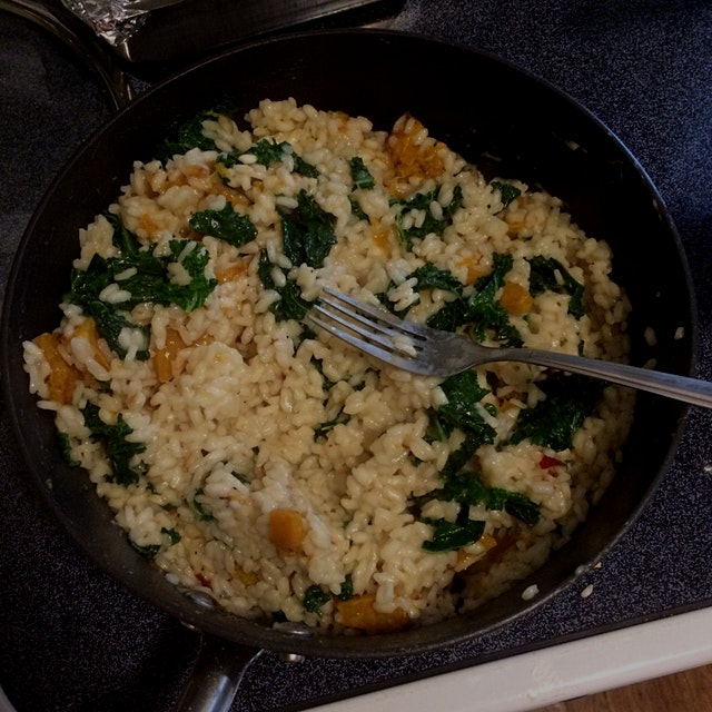 """Butternut squash and kale risotto is rich, comforting, and surprisingly healthy. Mix up a flavor..."