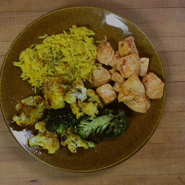 Harissa spiced chicken (organic) with yellow rice and roasted broccoli and cauliflower