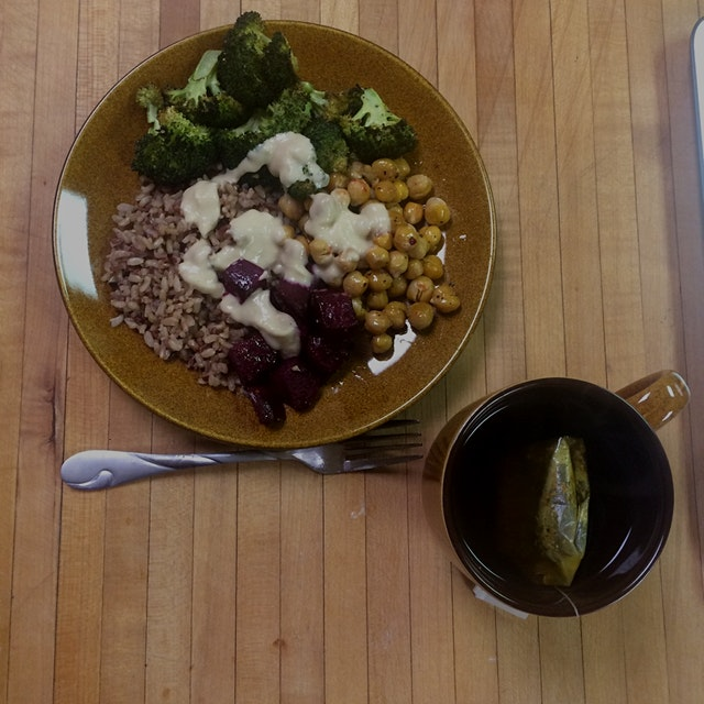 Roasted broccoli, beets, and chickpeas with sprouted brown rice, garlic hummus sauce, and ginger ...