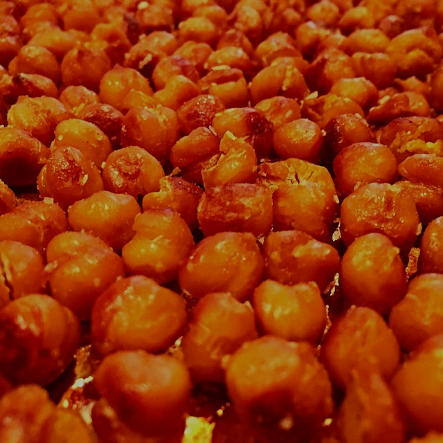 Roasted chickpea snack. Dry roast for 30 minutes at 400°. Toss with salt, curry powder (or whatev...