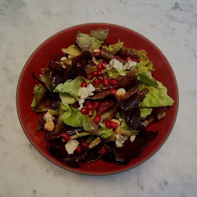 Pomegranate seeds, toasted hazelnuts and Roquefort (blue) cheese with butter lettuce are deliciou...