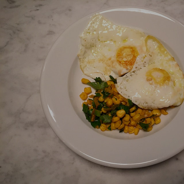Eggs pair with almost anything! I had some leftover corn salsa with cilantro, scallions, mint and...