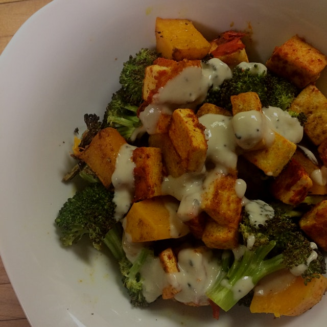 Roasted curried butternut squash & broccoli with harissa spiced tofu & a lemony hummus sauce